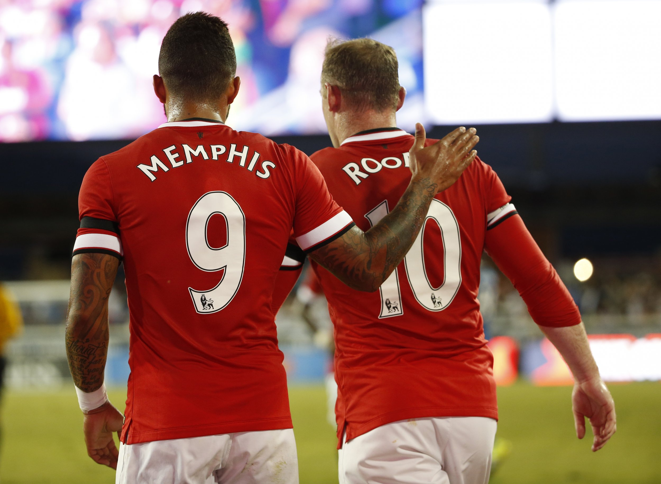 Memphis Depay, left, with Manchester United captain Wayne Rooney.