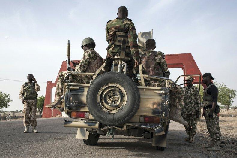 Nigerian soldiers prepare a convoy in Maiduguri