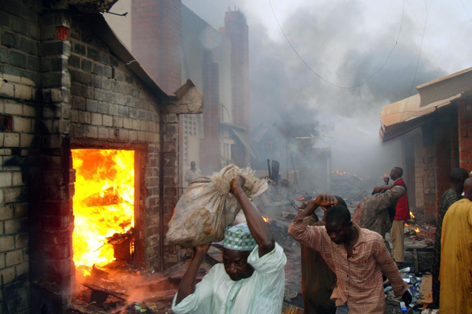 Traders at Sabon-Gari market salvage goods after a fire in Kano, Nigeria.