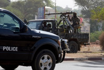 Nigerien soldiers patrol in Niamey.