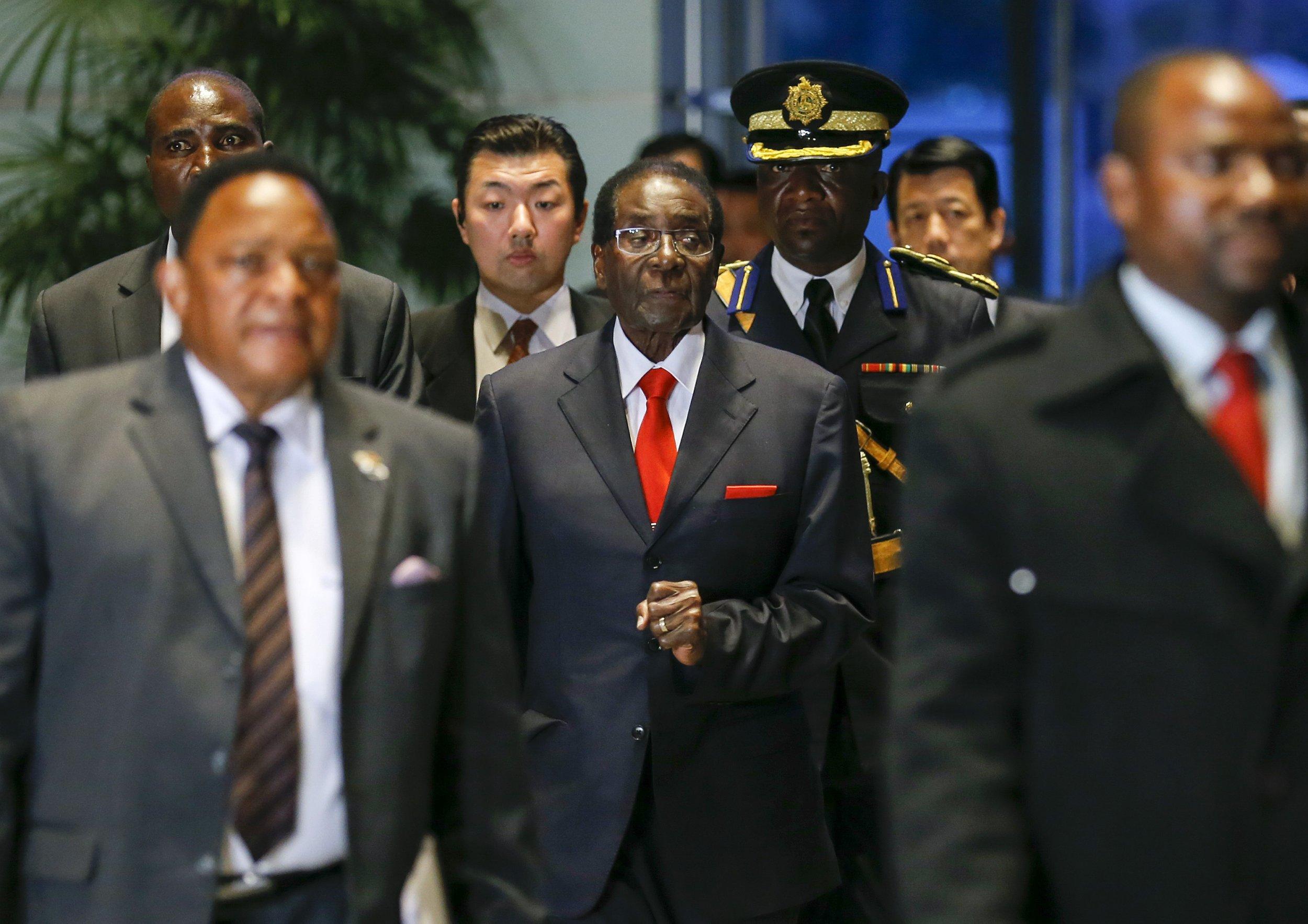 Zimbabwean President Robert Mugabe arrives for talks with Japanese Prime Minister Shinzo Abe in Tokyo.