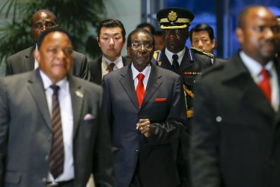 Zimbabwean President Robert Mugabe arrives for talks with Japanese Prime Minister Shinzo Abe in Tokyo.