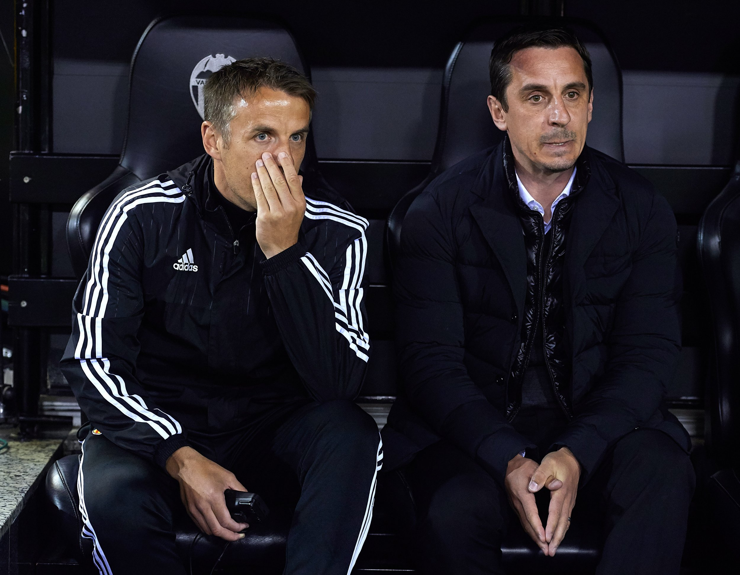 Gary Neville, right, with brother Phil during his time as Valencia manager.