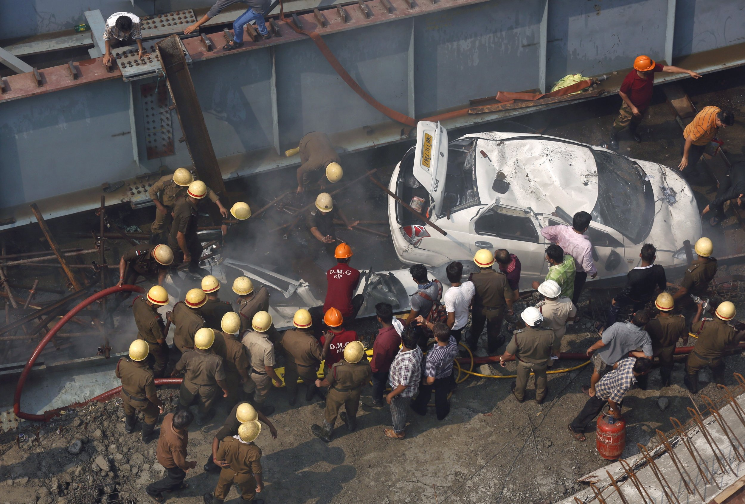 Rescue workers search for victims after India overpass collapses.