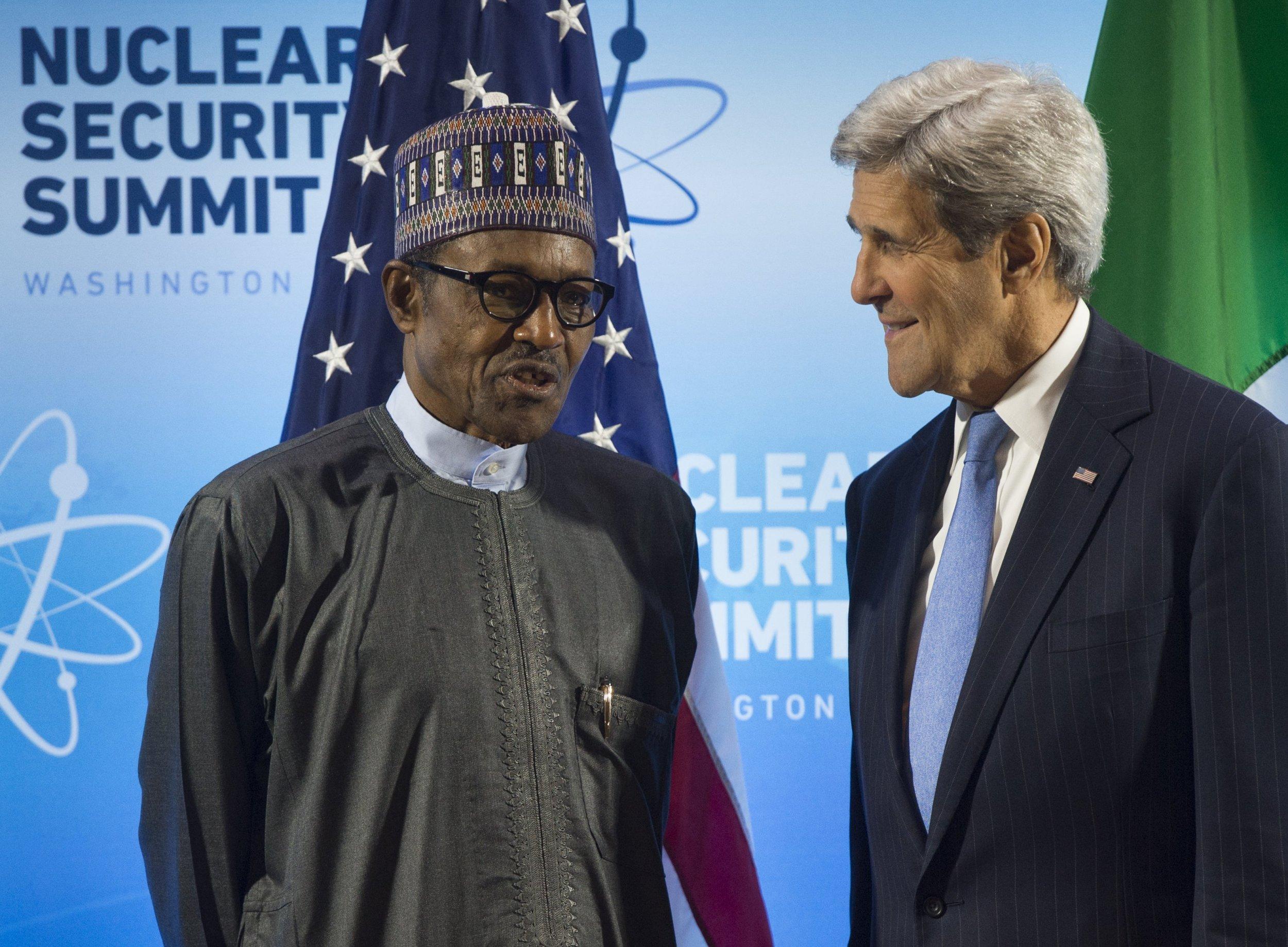 Nigerian President Muhammadu Buhari speaks with U.S. Secretary of State John Kerry.