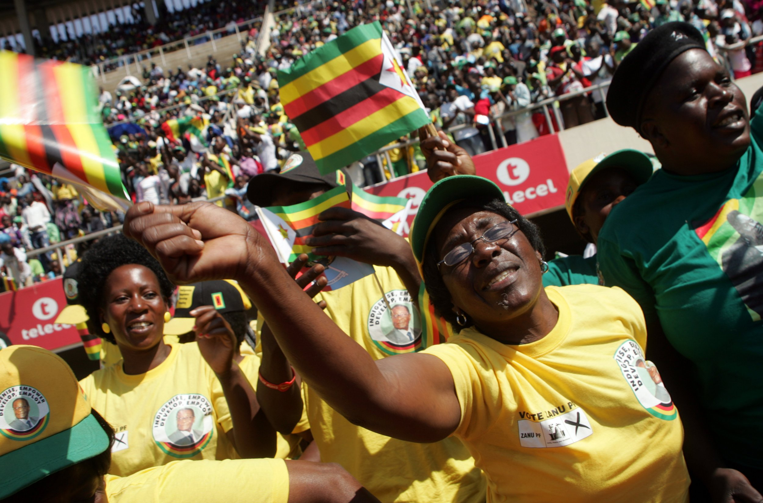 Supporters of Zimbabwe President Robert Mugabe cheer.