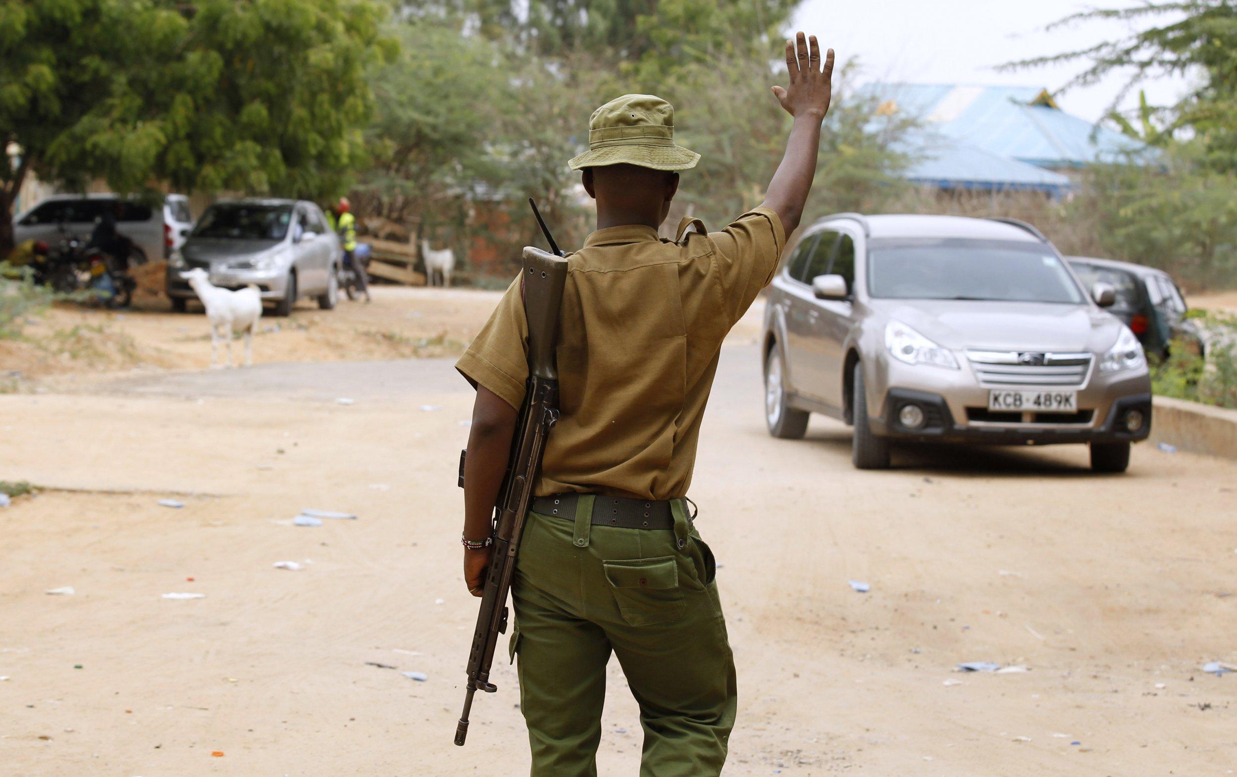 A Kenyan police officer stops a car outside Garissa University College.