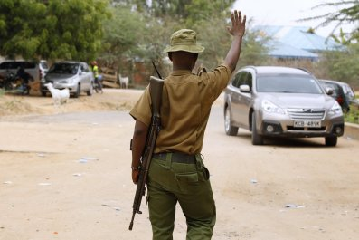 A Kenyan police officer stops a car outside Garissa University College.