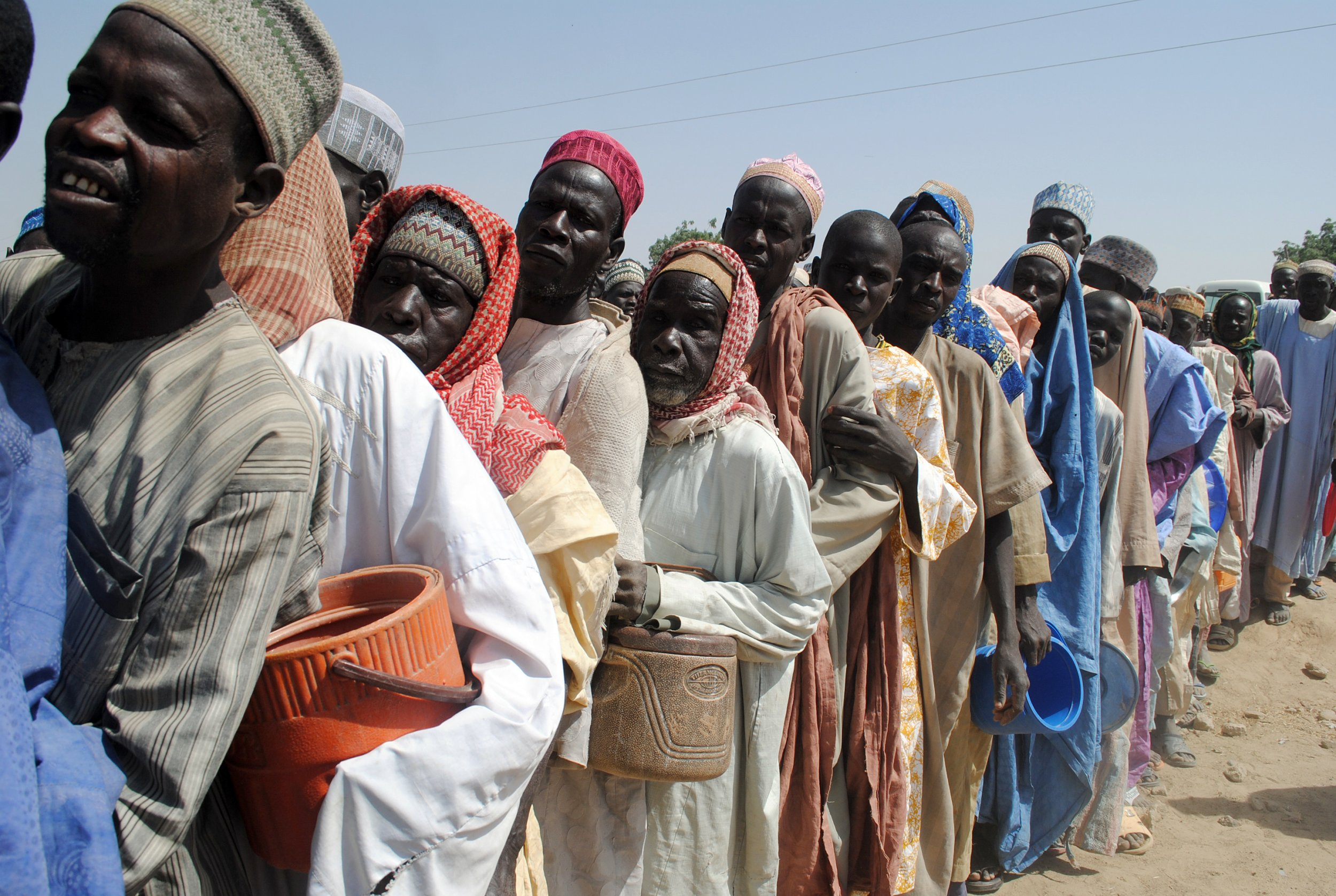 People displaced by Boko Haram queue for food in Dikwa Camp, Borno, Nigeria.