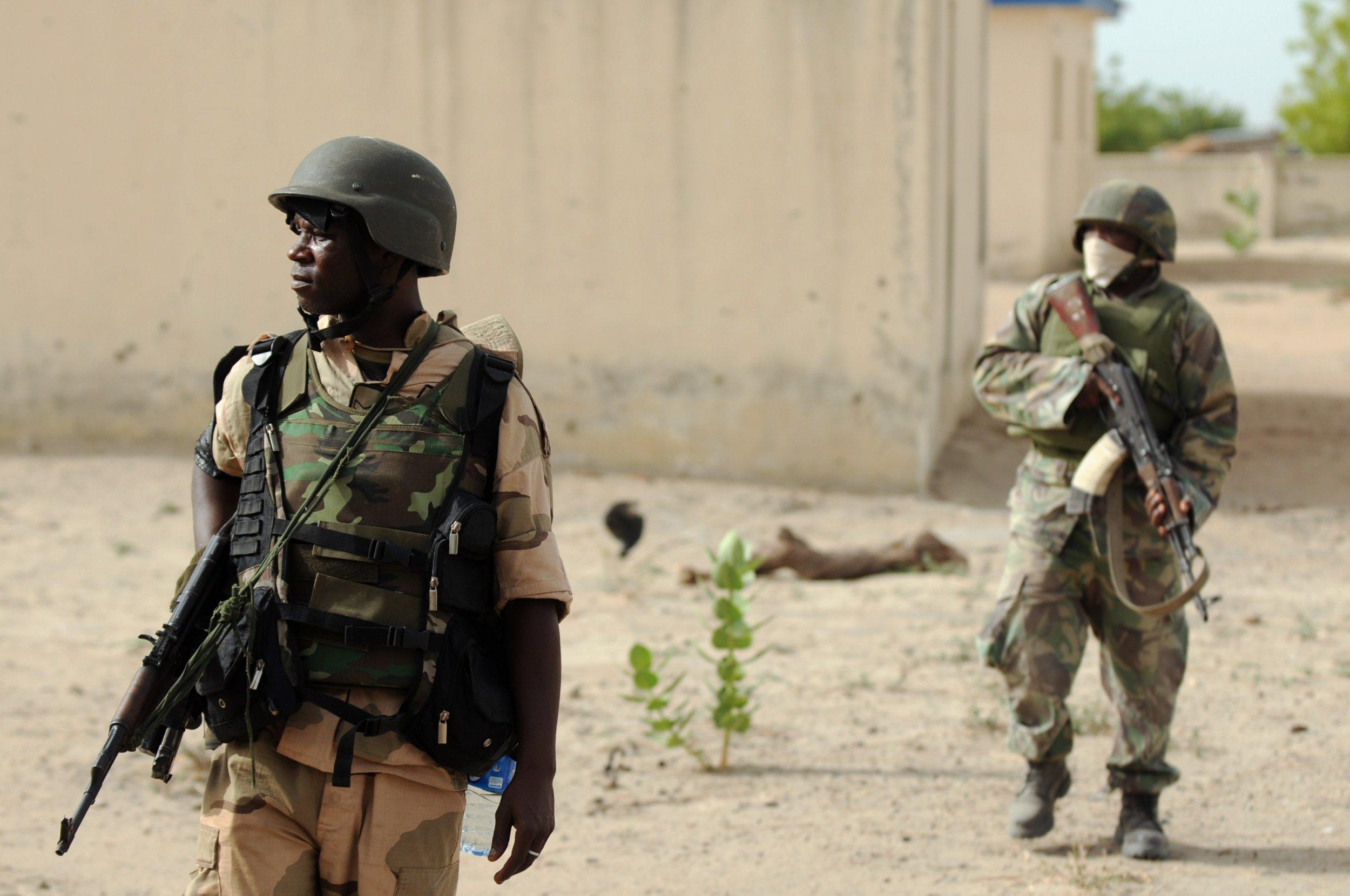 Nigerian soldiers patrol near a former Boko Haram camp in Borno.
