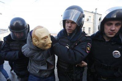 Putin mask arrest