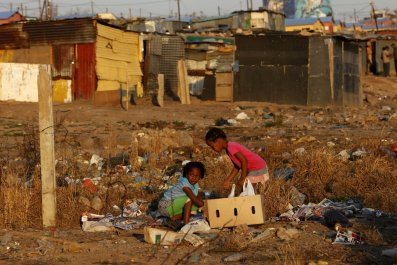Children play at a rubbish dump in Soweto, Johannesburg.