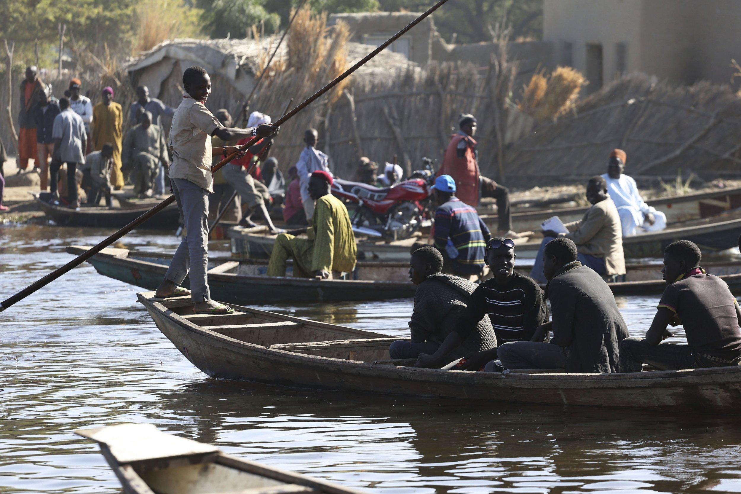People cross Lake Chad.