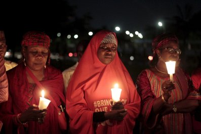 Bring Back Our Girls campaigners light candles.