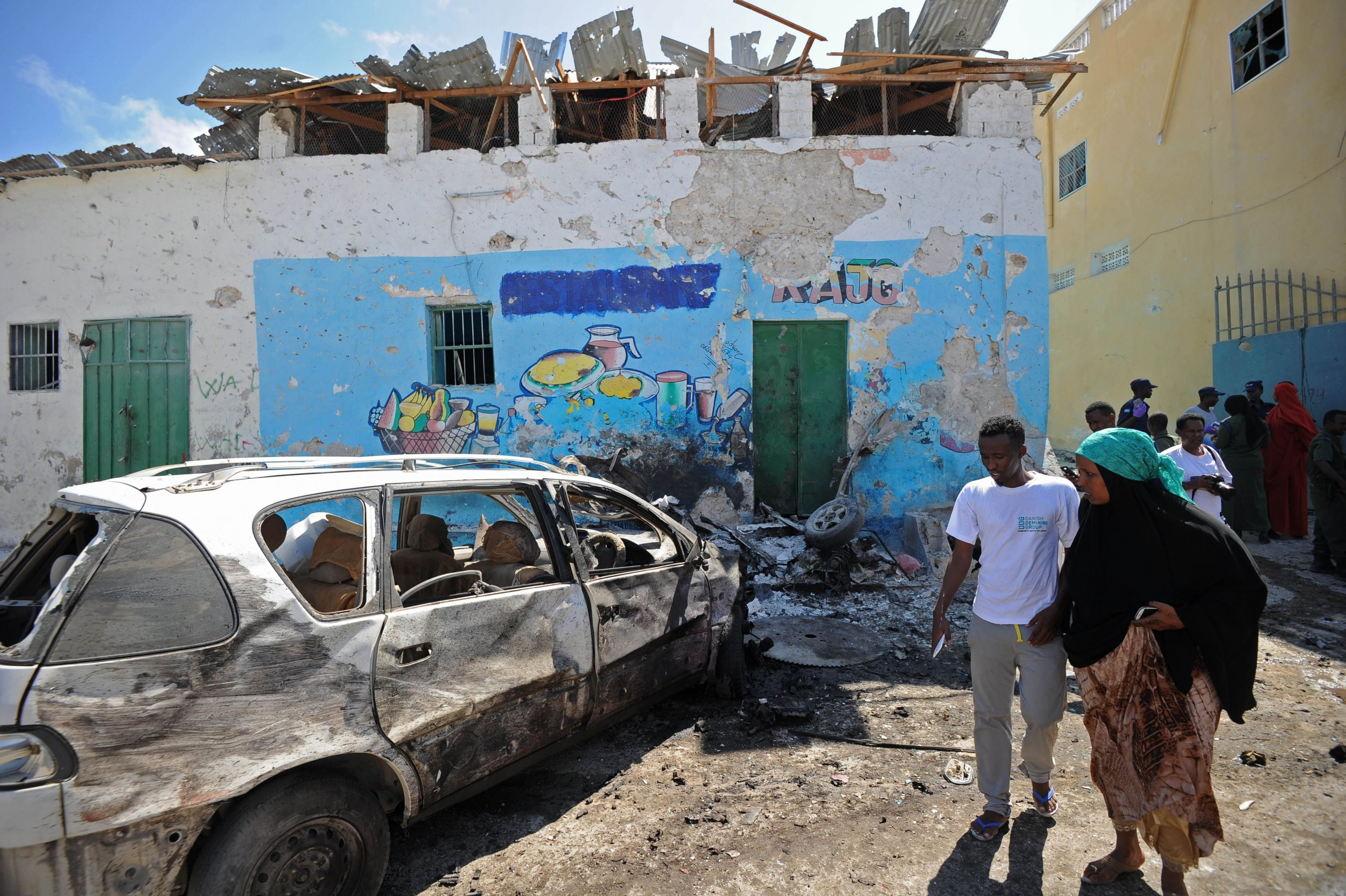 People view the wreckage of a car bomb in Mogadishu, Somalia.