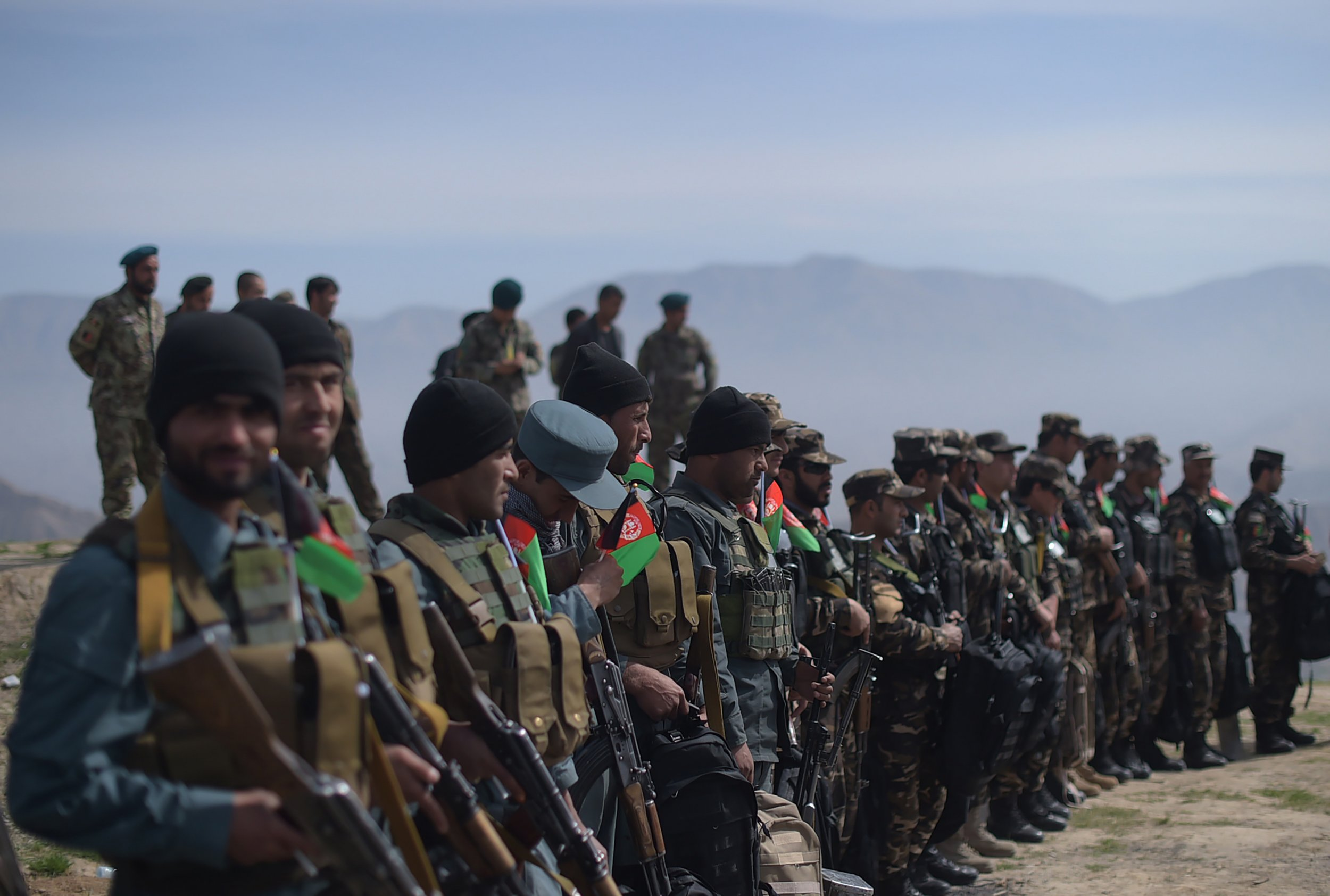 Afghan soldiers line up after weeks of fighting against the Taliban.