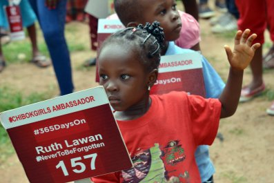 A young girl campaigns for the missing Chibok girls abducted by Boko Haram.