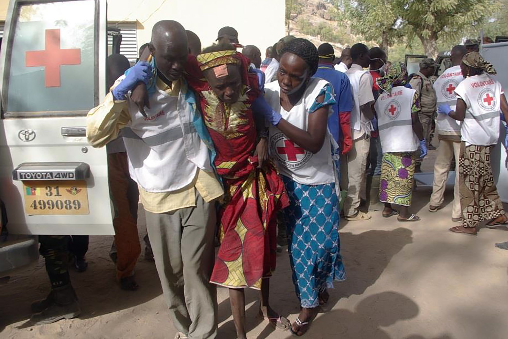A wounded woman is evacuated after a Boko Haram suicide attack in Cameroon.