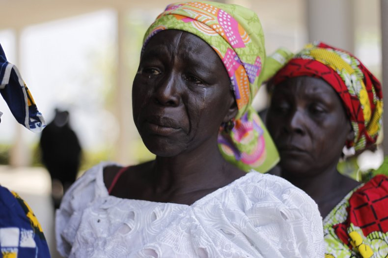Parents of the Chibok girls weep during a meeting with President Muhammadu Buhari.