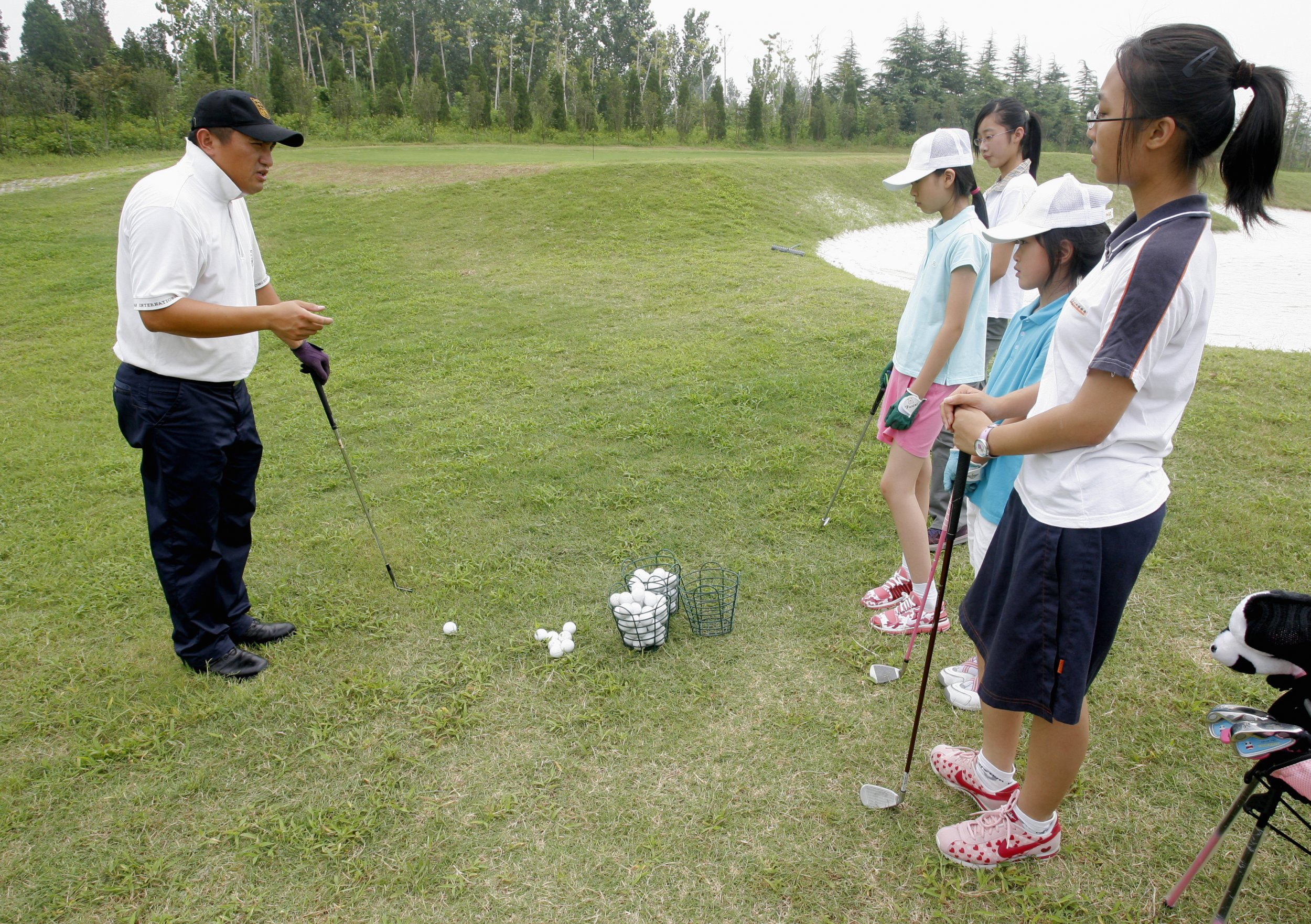 Chinese children take a golf lesson.