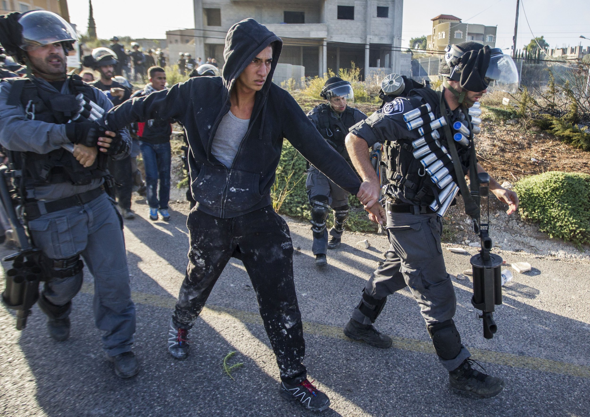 Israeli police detain an Arab-Israeli youth in Kafr Kanna, Israel.