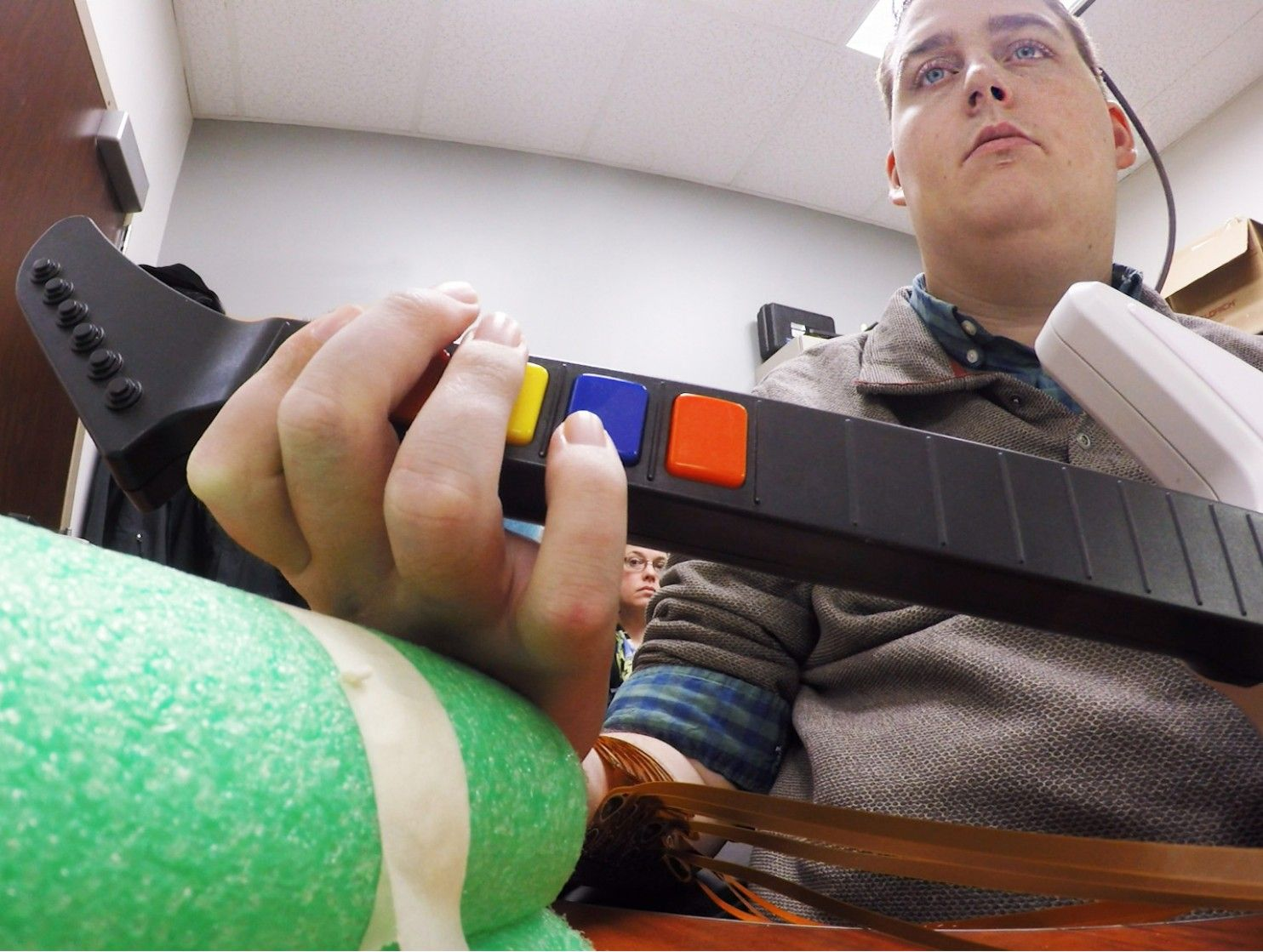 paralyzed brain chip hand guitar hero