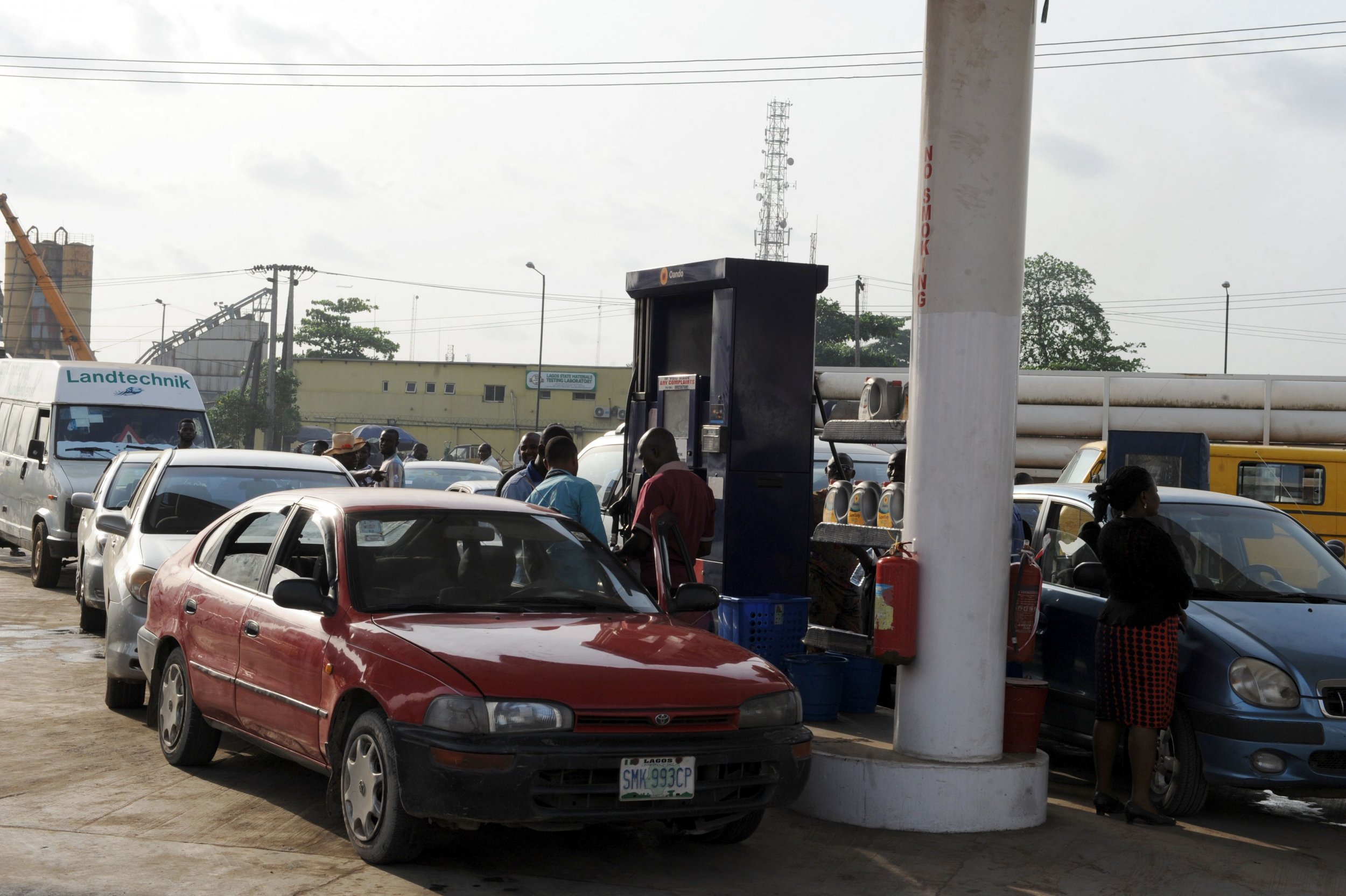 Nigerian motorists queue for fuel in Lagos.