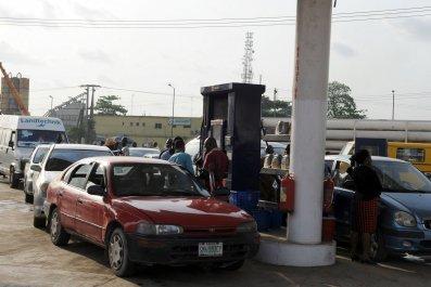 Nigerian motorists queue for fuel in Lagos.