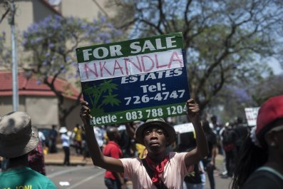 A South African protestor holds an Nkandla sign in Pretoria.