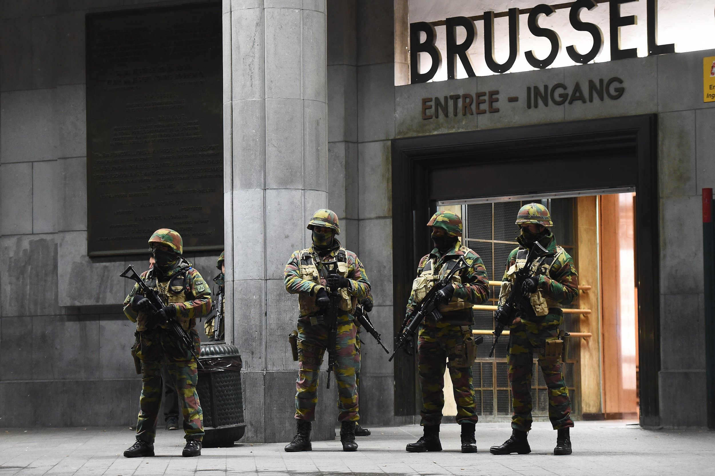 Belgian police guard the central Brussels train station.