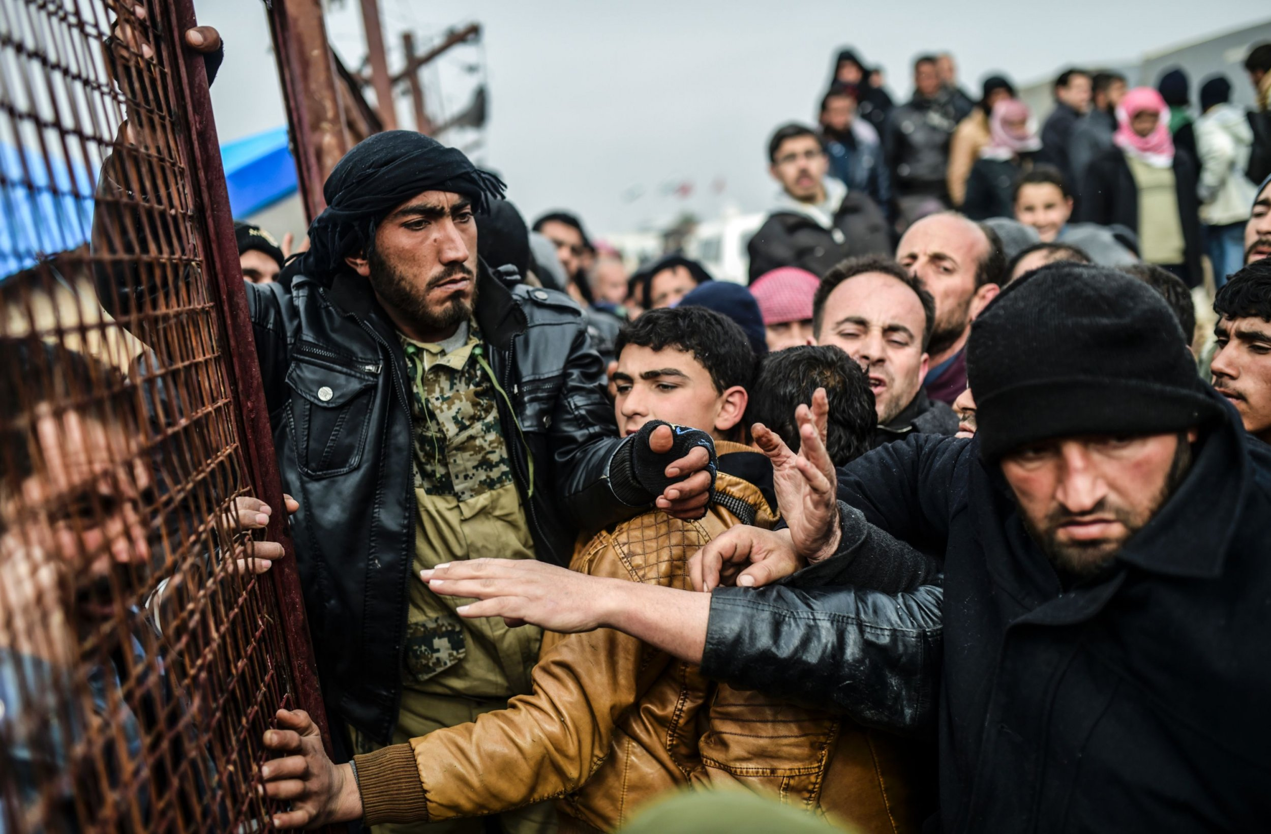 Syrian refugees wait for tents at Azaz, near the Turkish border.