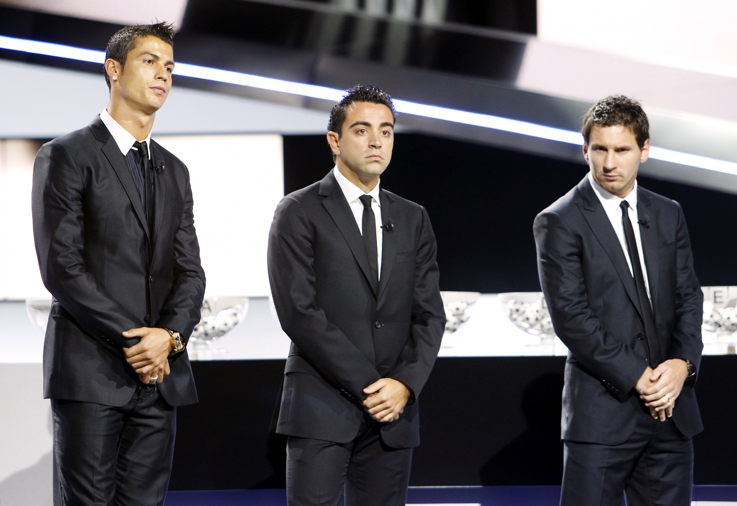 Cristiano Ronaldo, left, Xavi Hernandez, centre, and Lionel Messi in Monaco, August 2011.