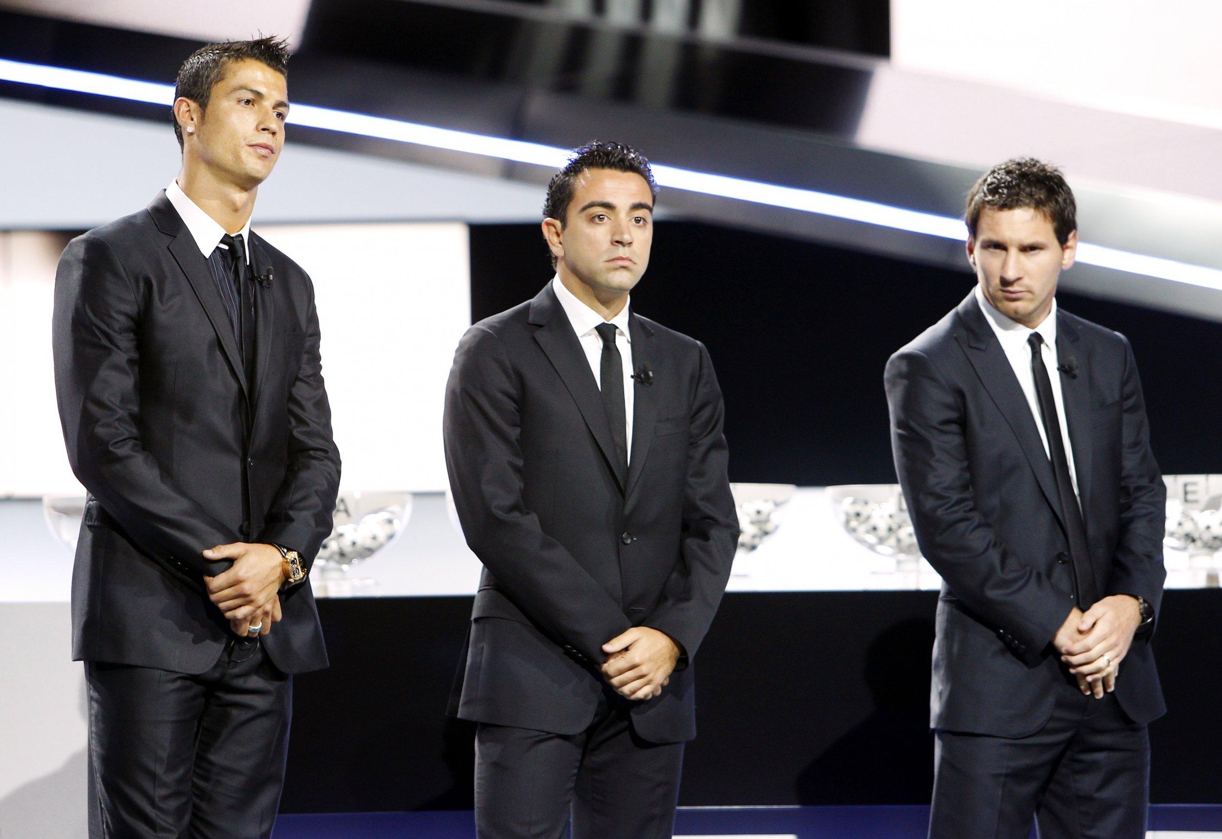 Cristiano Ronaldo, left, Xavi Hernandez, centre, and Lionel Messi in Monaco, August 2011.