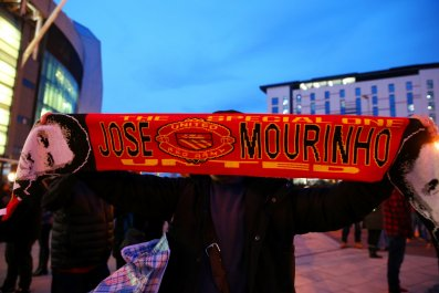 A Manchester United fan displays his support for Jose Mourinho at Old Trafford.