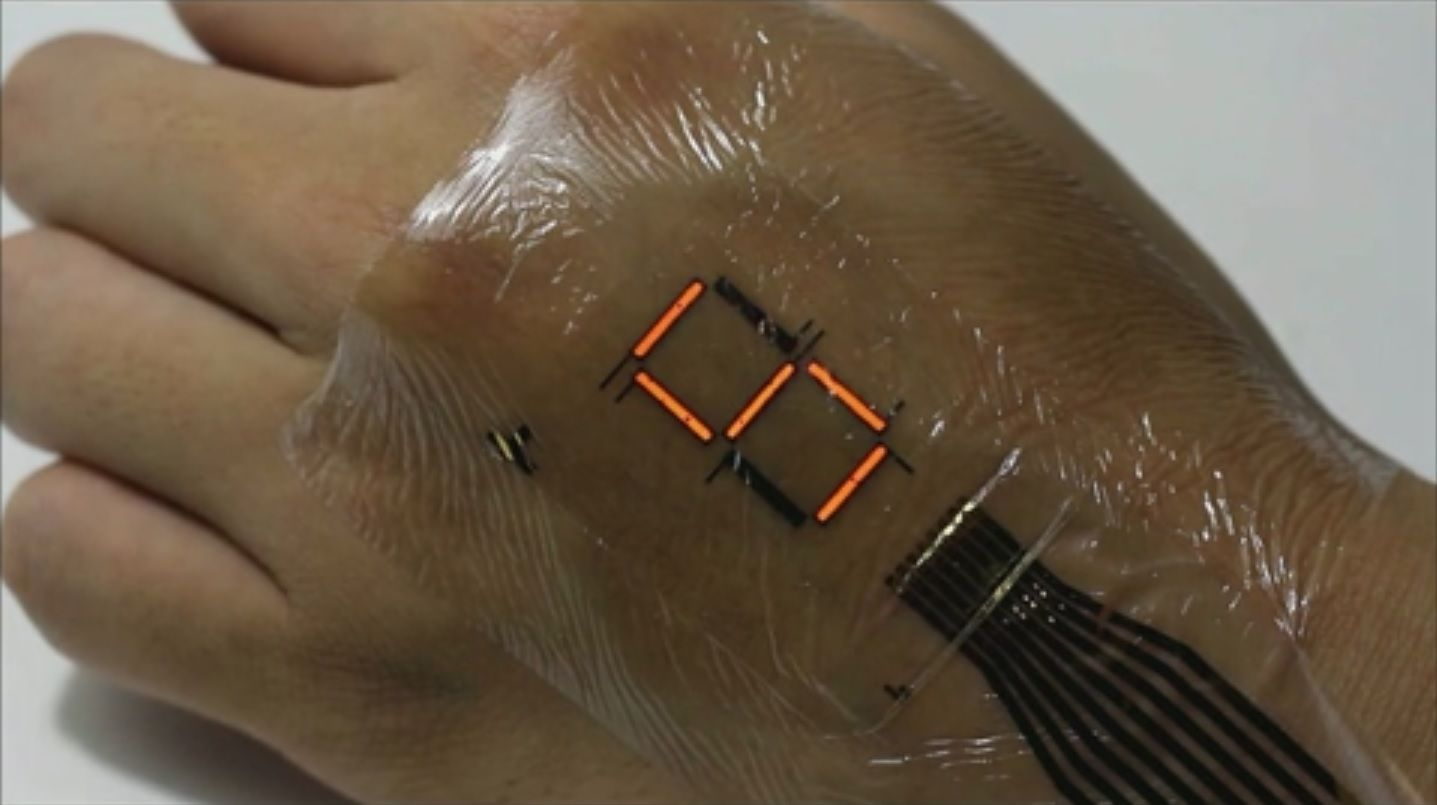 Electronic tattoo transforms skin into a screen for Artificial skin for tattooing