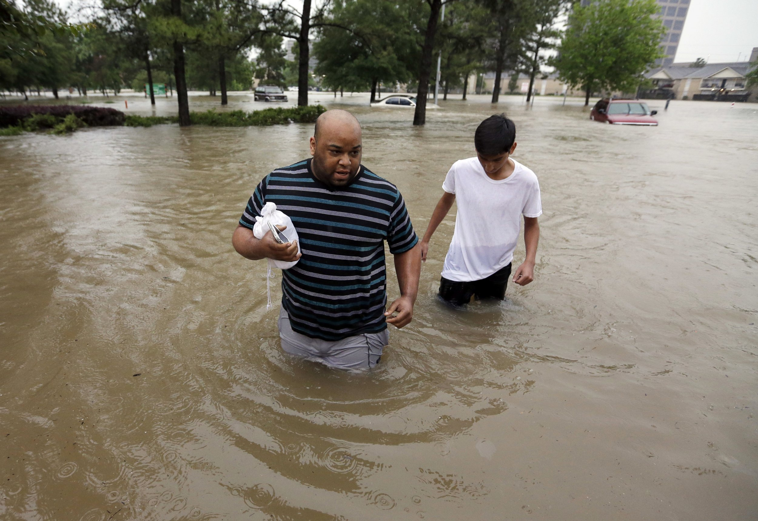 Video Shows Local Reporter Rescuing Man In Houston ...
