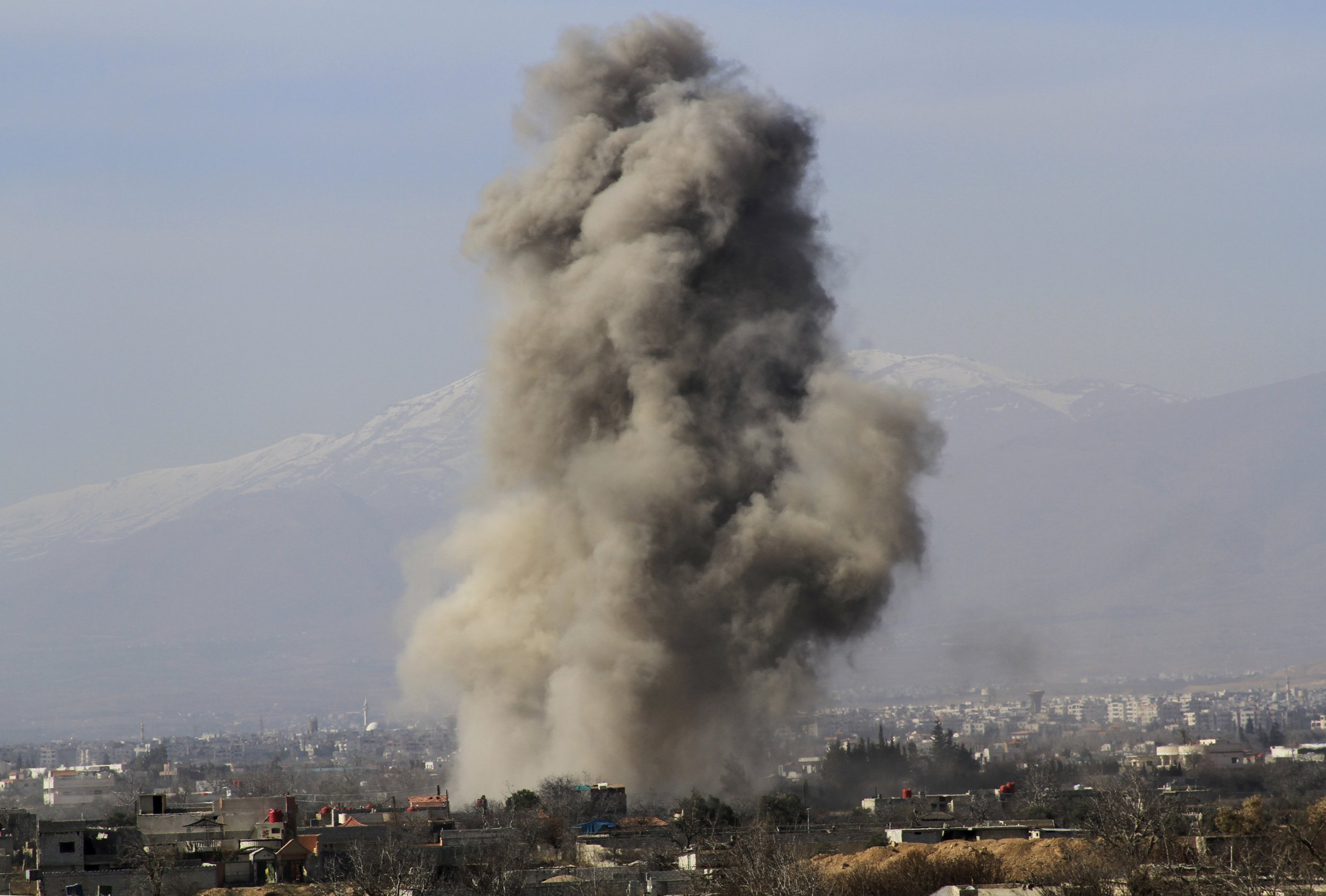 Smoke from barrel bombs