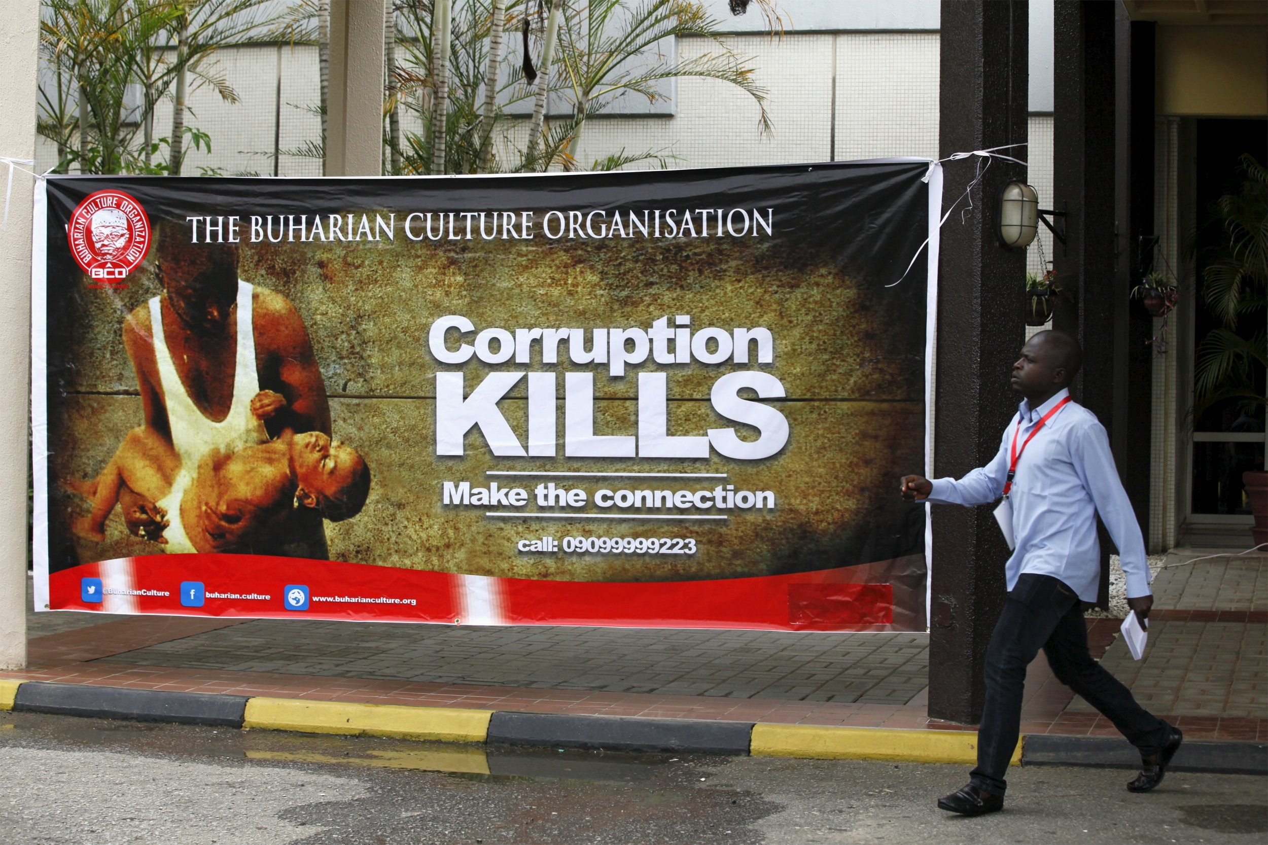 A man arrives at a meeting of an anti-corruption group inspired by President Buhari in Nigeria.