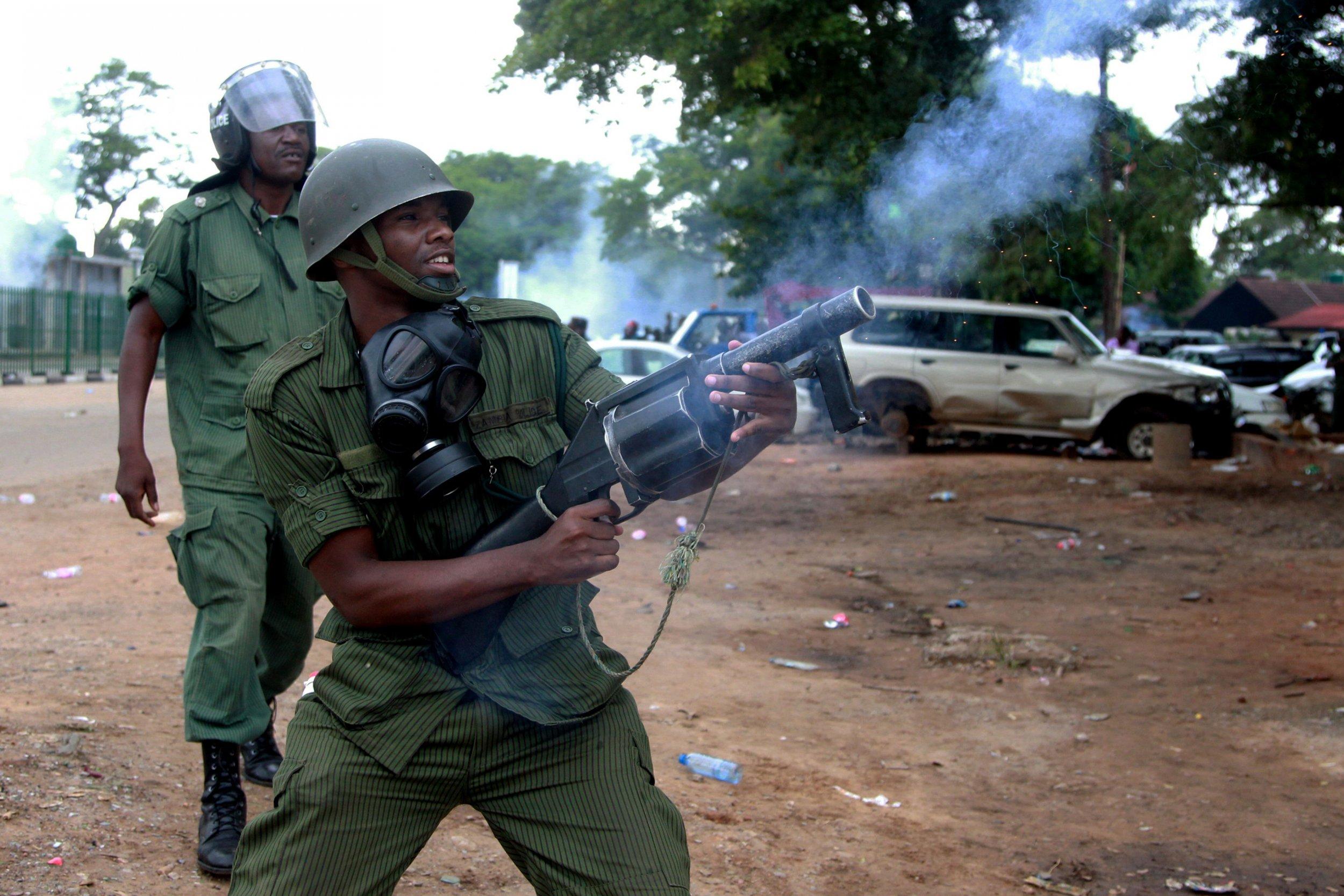 Zambian policeman fires tear gas in Lusaka.