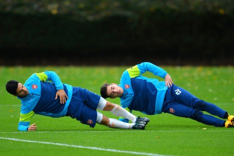 Mikel Arteta and Hector Bellerin compete in a game of head-tennis.