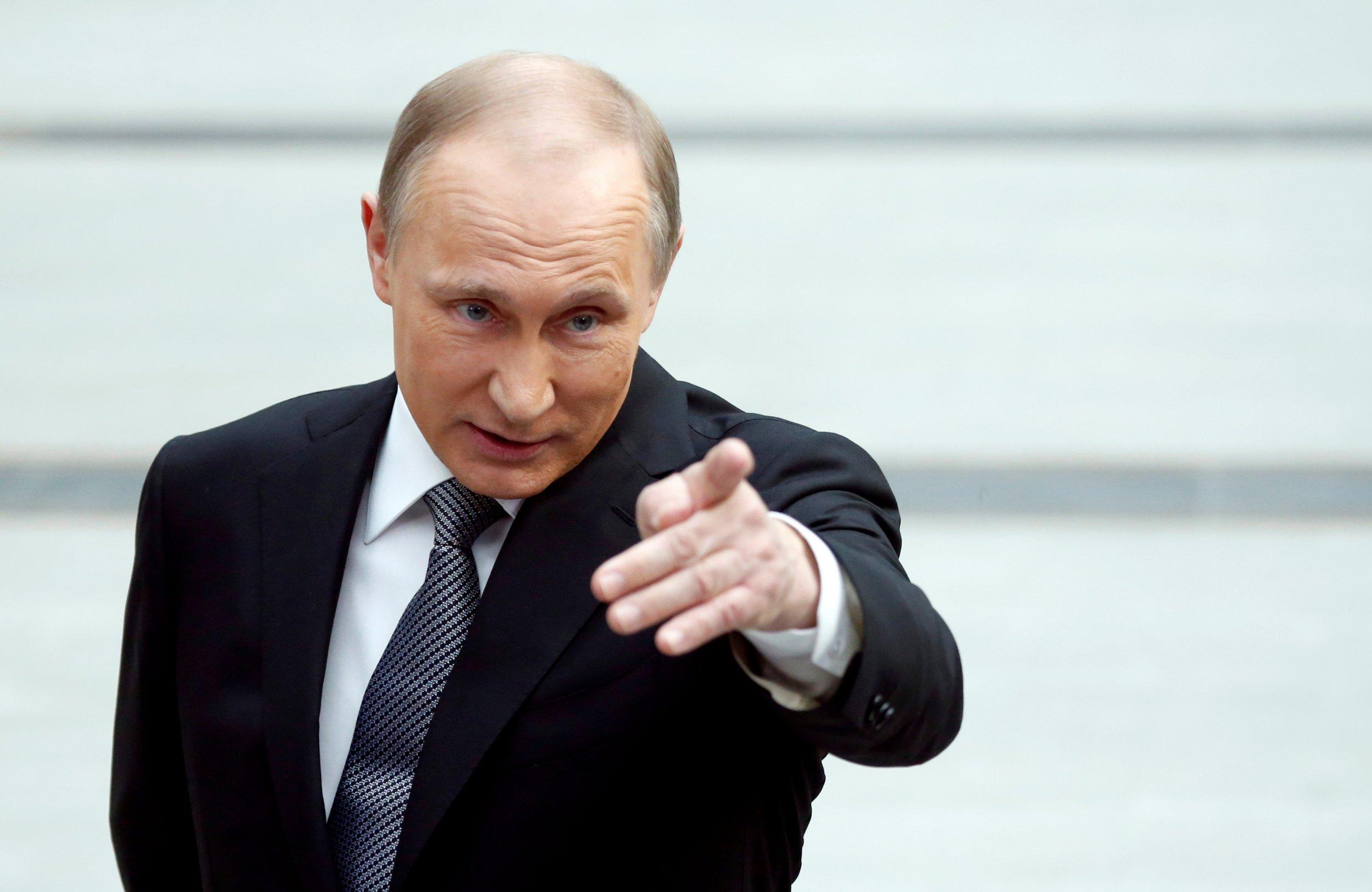 Putin points to camera
