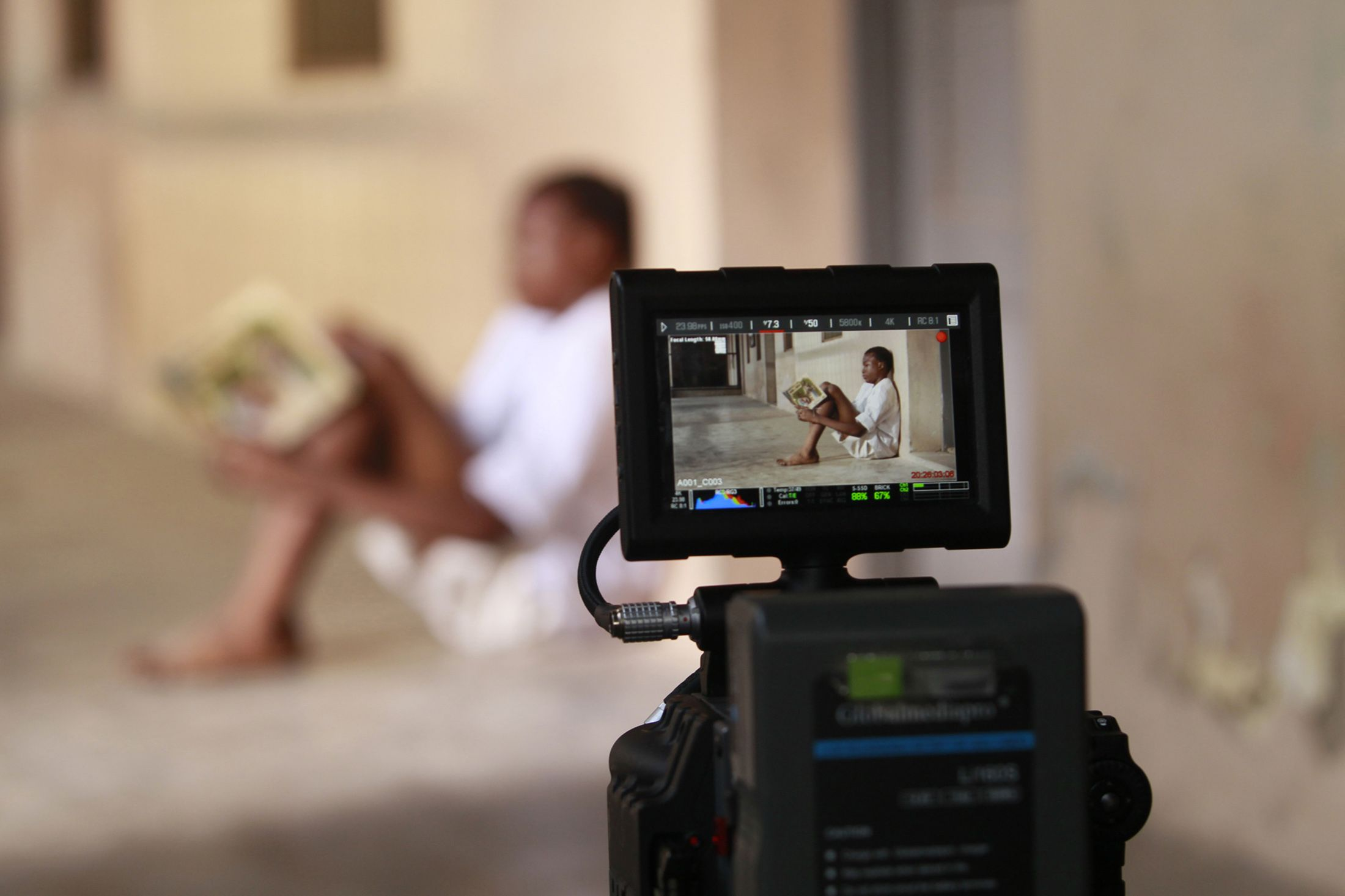 A boy acts in a Nollywood film.