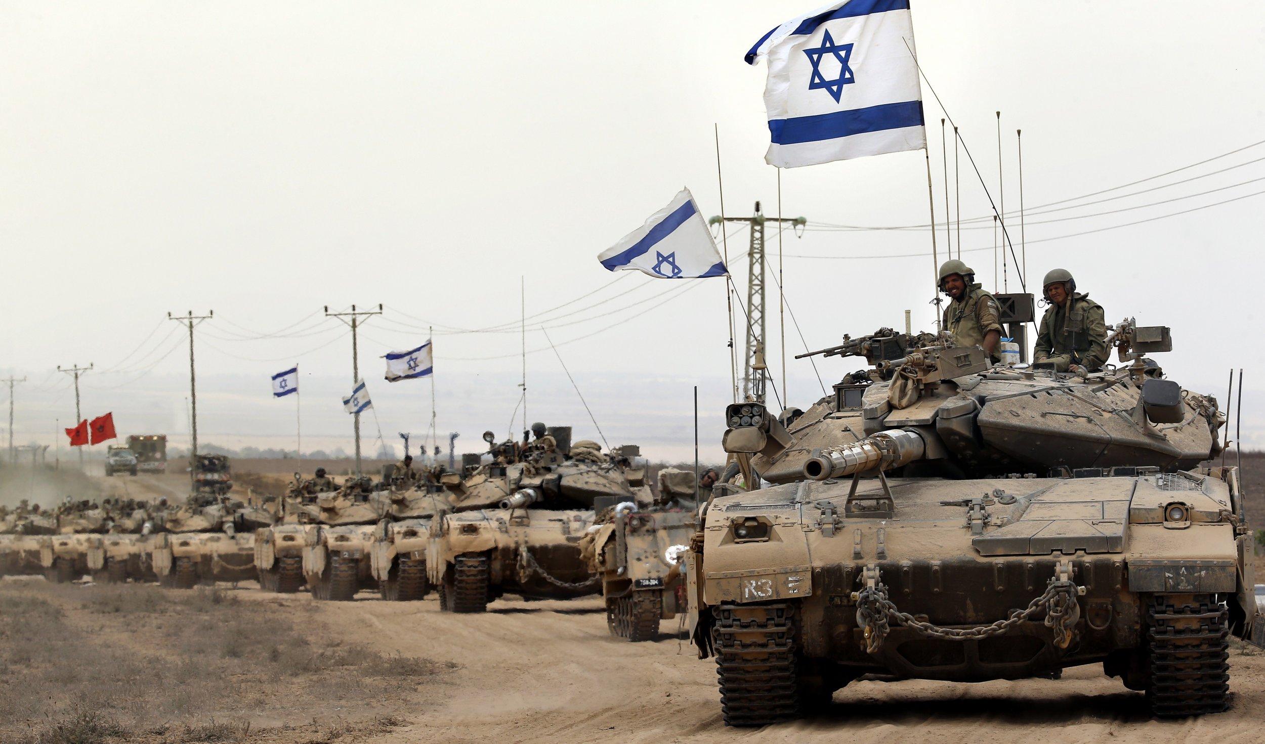 Israeli tanks return from the Gaza Strip.