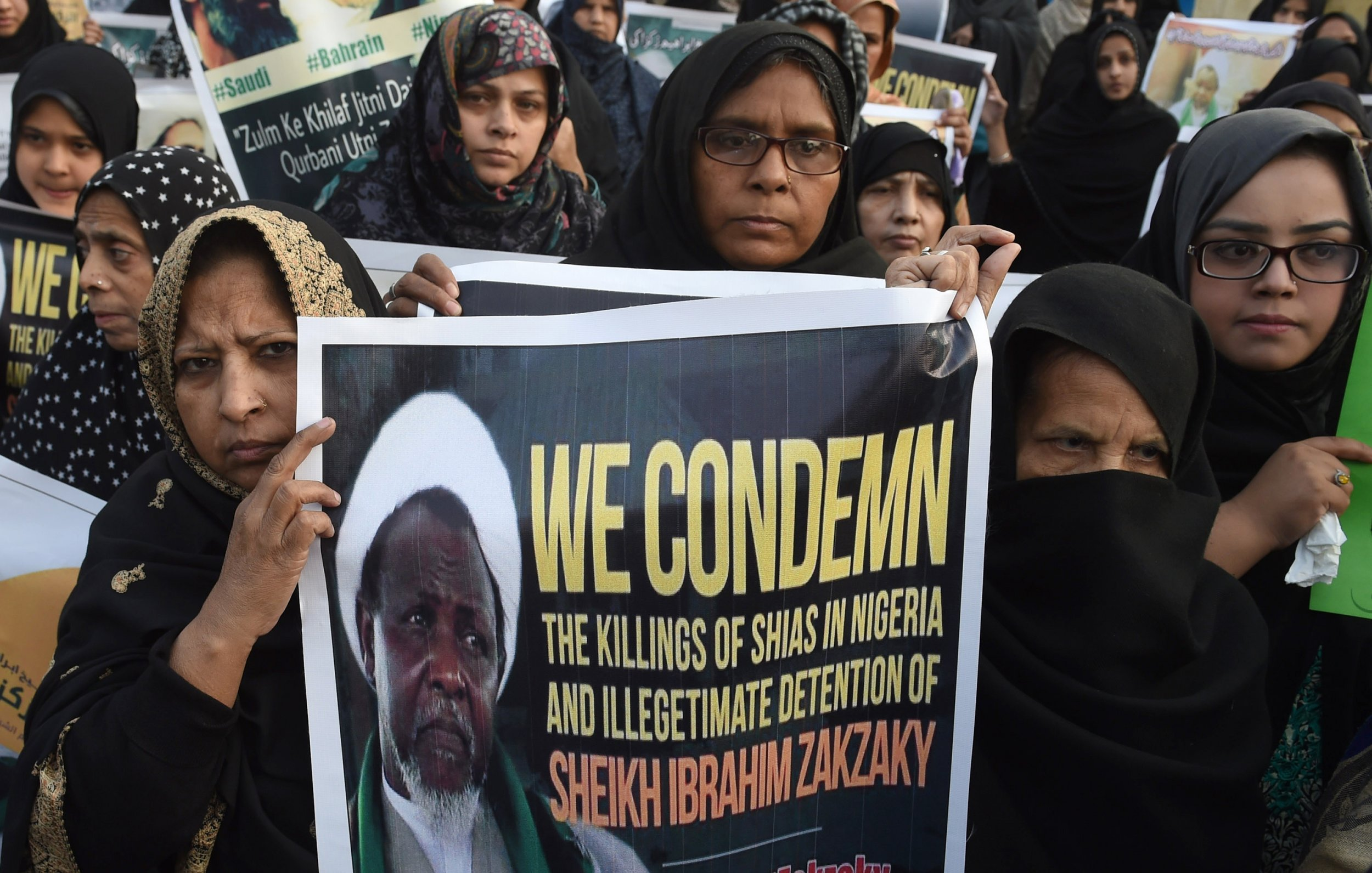 Pakistani Shiite Muslims carry Sheikh Zakzaky placard.