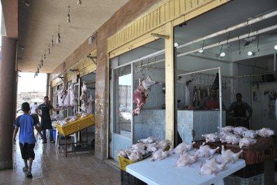 Selling meat in Derna, Libya
