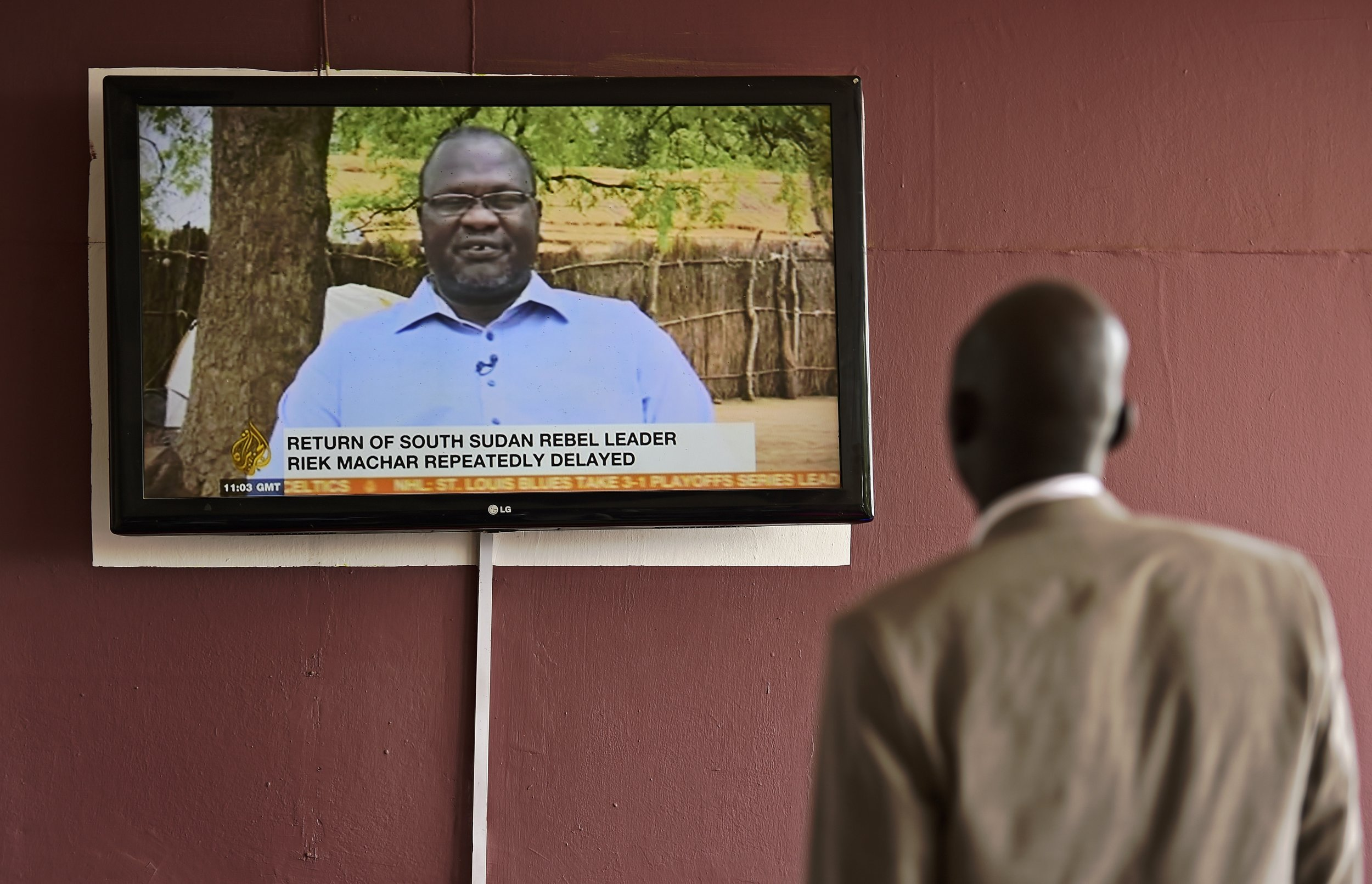 Riek Machar's delayed return to South Sudan on the news.