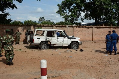 Burundian security officers at the scene of a killing