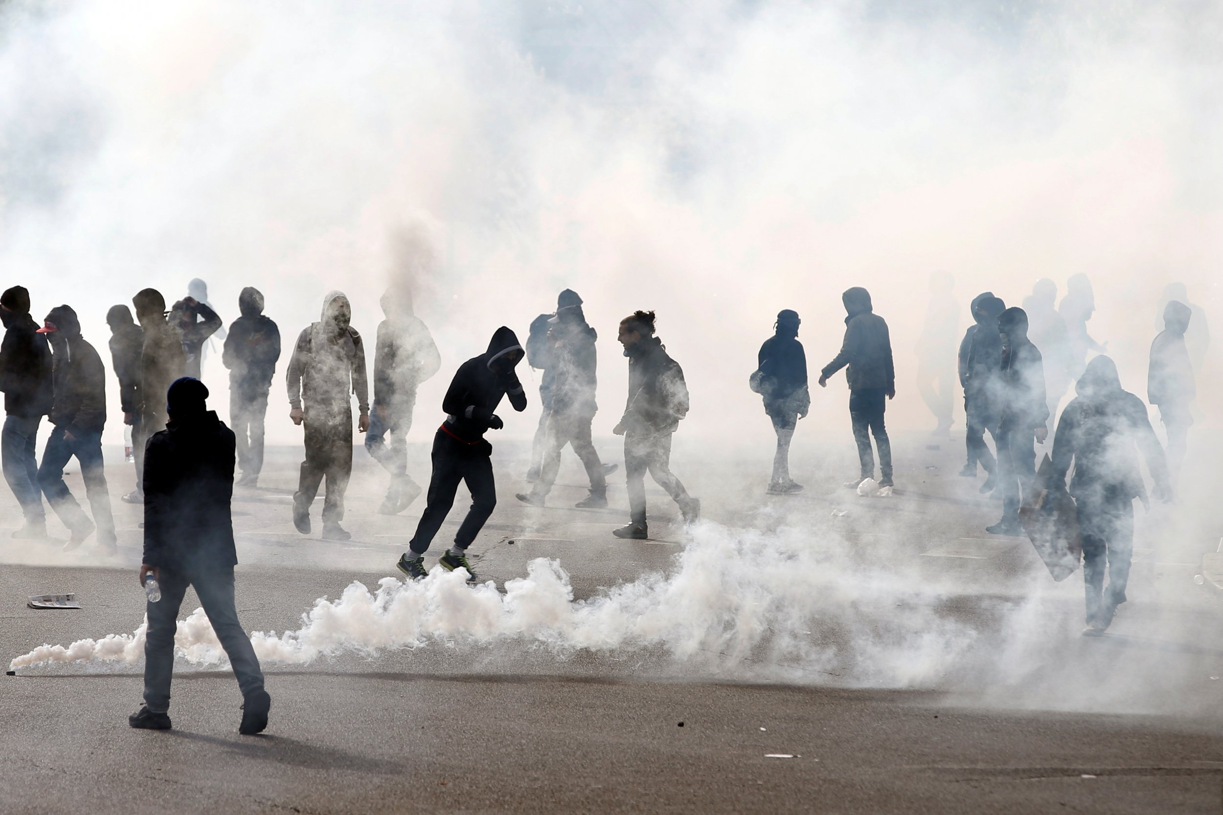 Masked youths and tear gas