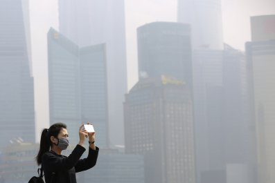 Woman Takes Pictures in Shanghai Smog