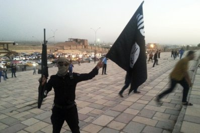 ISIS fighter and flag